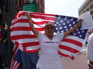 women carrying the Amerian flag